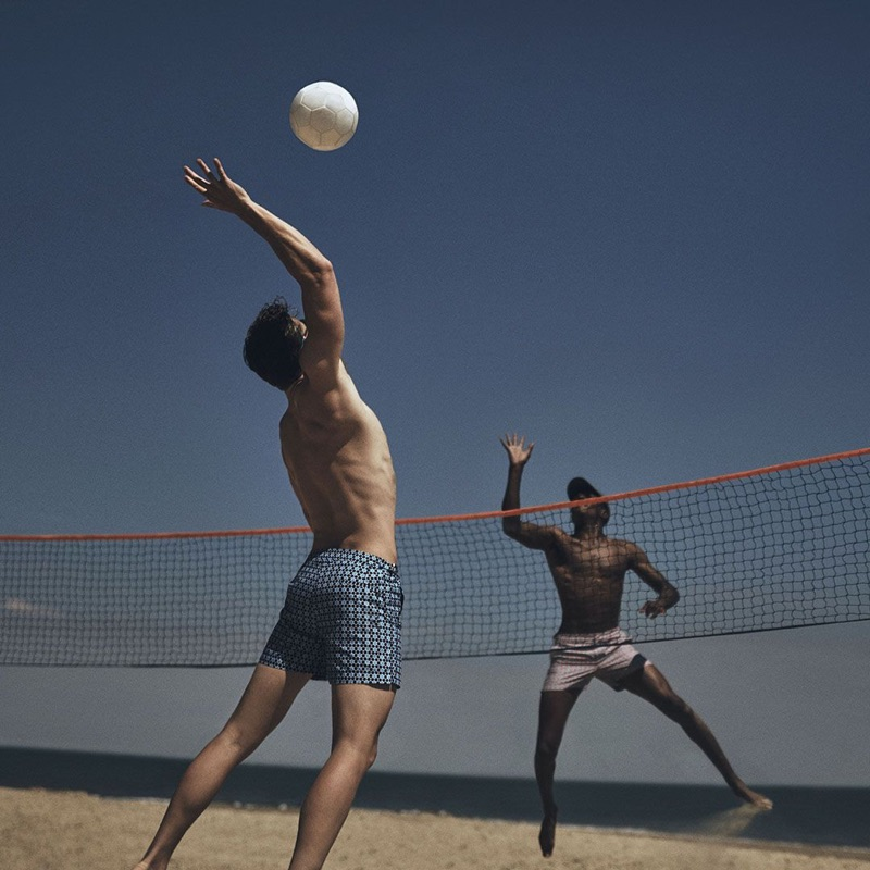 Playing volleyball, Edward Wilding and O'Shea Robertson don Orlebar Brown swimwear.