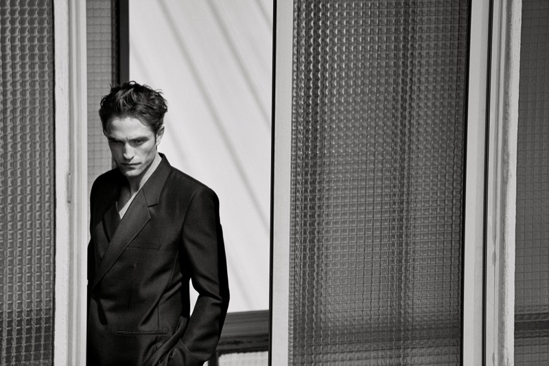 Donning a double-breasted suit, Robert Pattinson fronts Dior Men's spring-summer 2019 campaign.