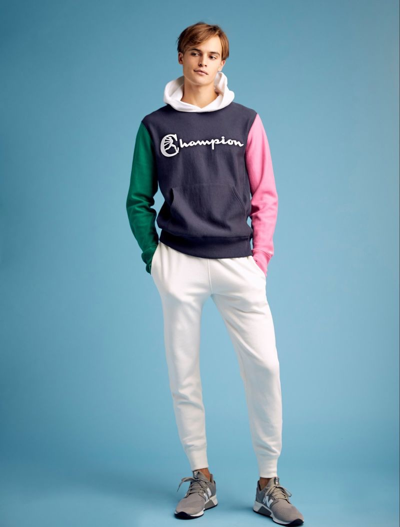 Showcasing resort style, Parker van Noord dons a Todd Snyder + Champion color block hoodie and white jogger sweatpants.