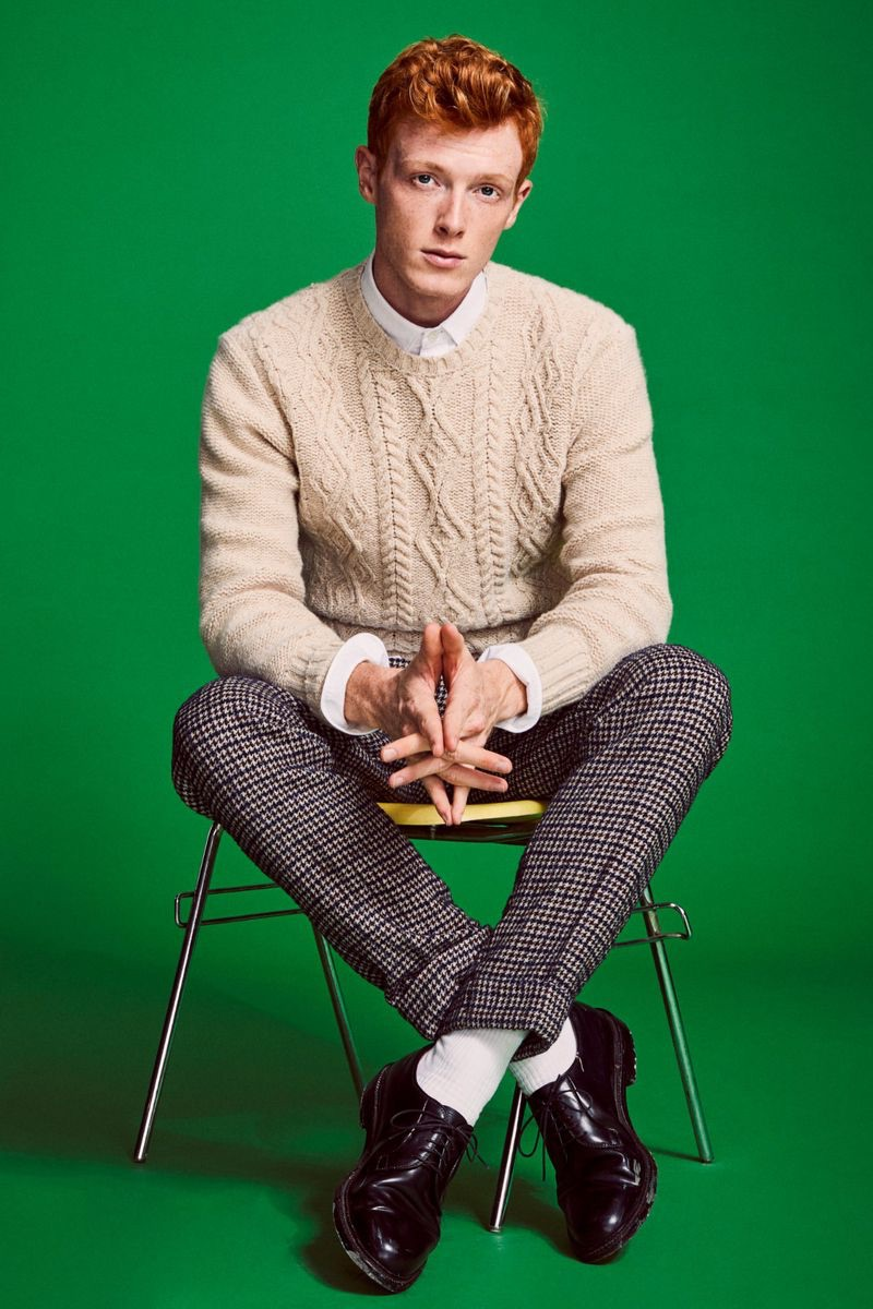 Dressed to impress, Linus Wordemann models an Inis Meain cable-knit sweater with a Todd Snyder houndstooth trousers.