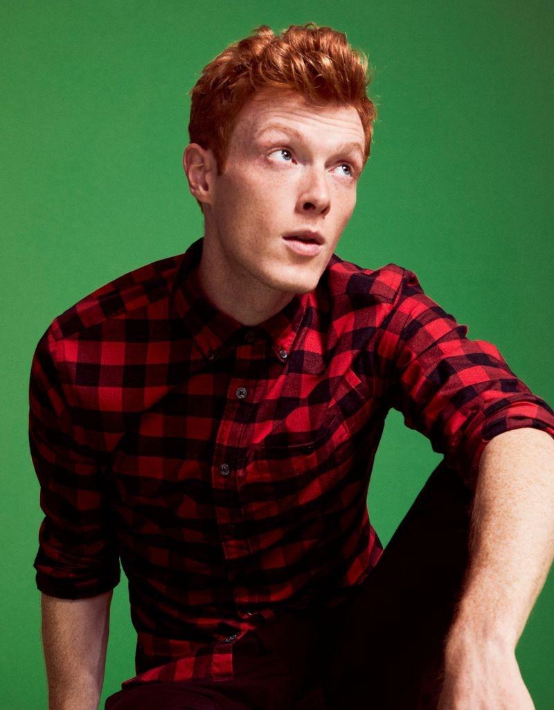 Model Linus Wordemann rocks a Todd Snyder red buffalo check button-down shirt.
