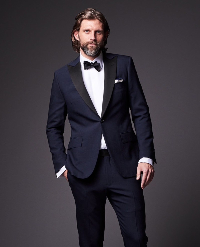 Dressed to the nines, RJ Rogenski wears Todd Snyder's tuxedo with a Drake's bow-tie.
