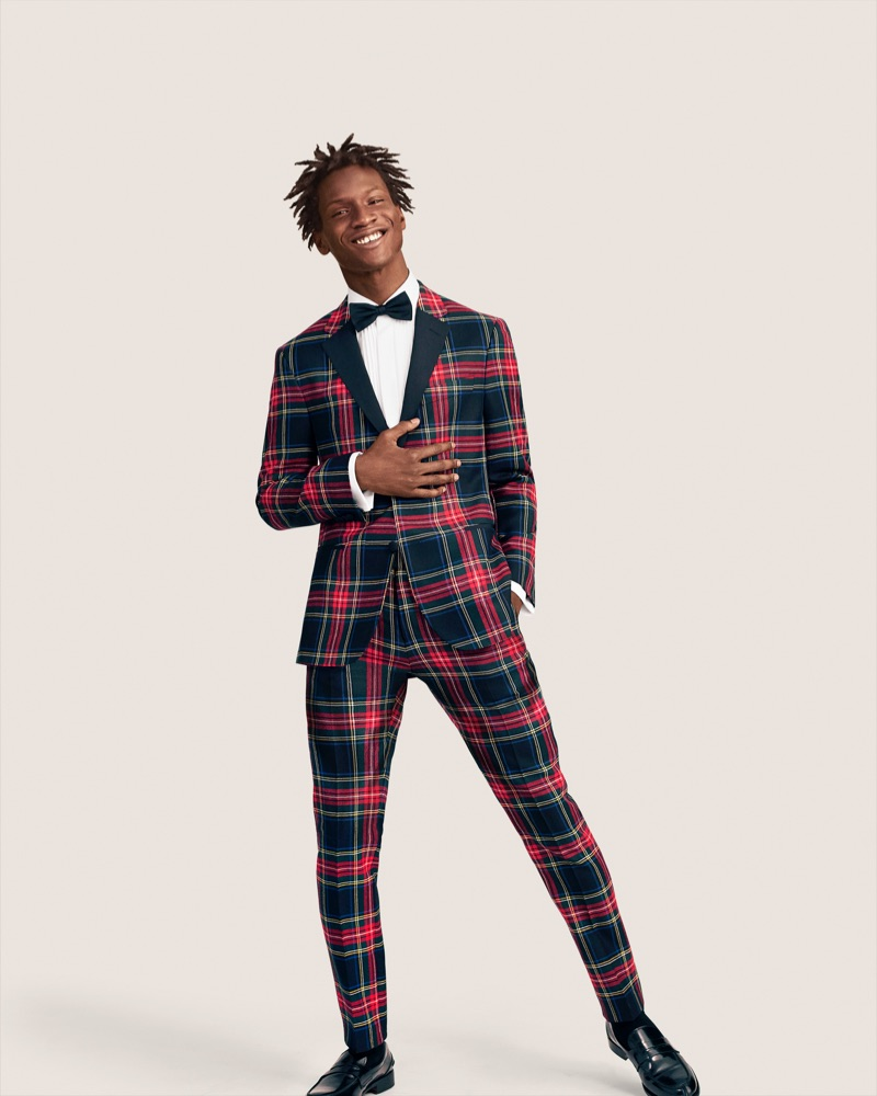Adonis Bosso dons a wool tartan suit from Tommy Hilfiger.