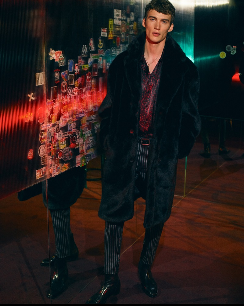 Lukas Adriaensens sports a faux fur coat with a leopard print shirt and pinstripe trousers from Zara Man.