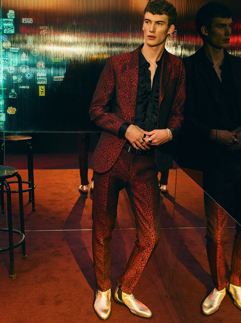 Model Lukas Adriaensens makes a statement in a red printed suit and gold boots, courtesy of Zara Man.