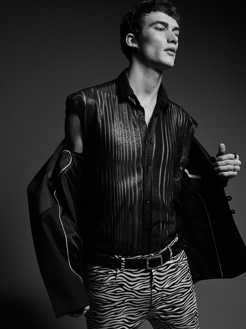 Destined to be the life of the party, Lukas Adriaensens wears a sleeveless shirt, zebra print pants, and a jacket from Zara Man.