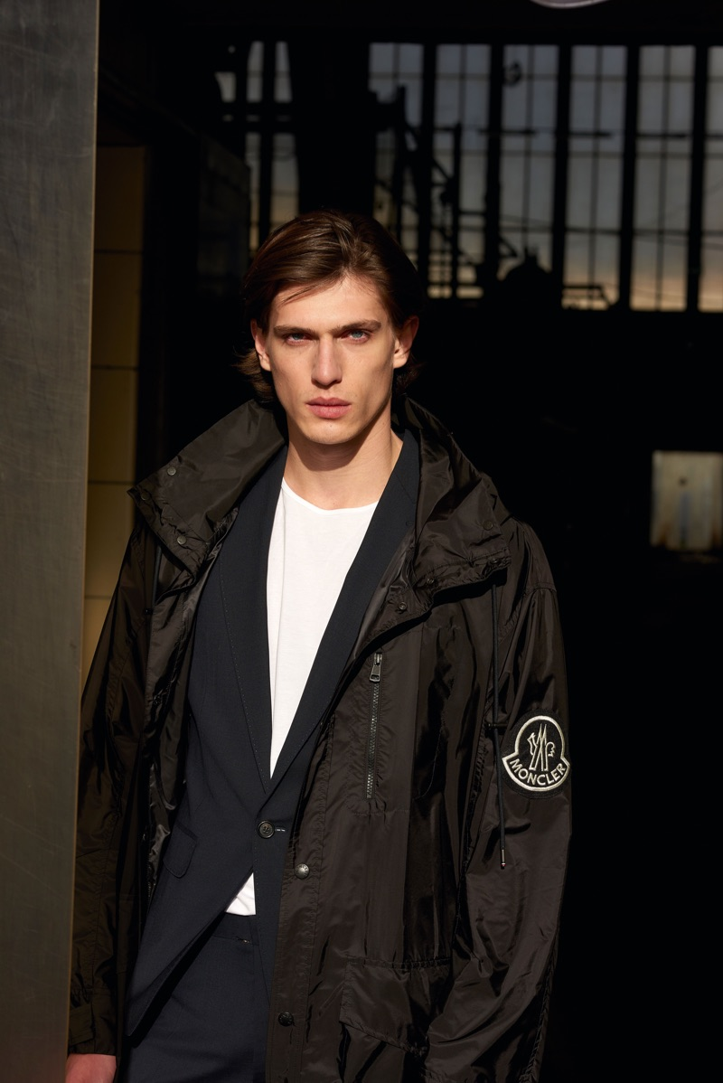 Model Edoardo Sebastianelli wears a Moncler coat with a Dsquared2 suit and a tee by The White Briefs.