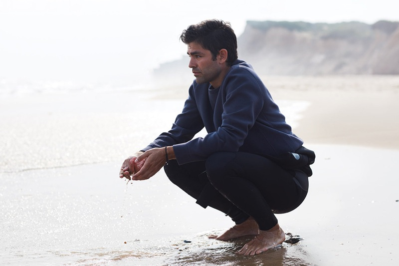 Picture-perfect, Adrian Grenier dons a life/after/denim sweatshirt with a Body Glove wetsuit.
