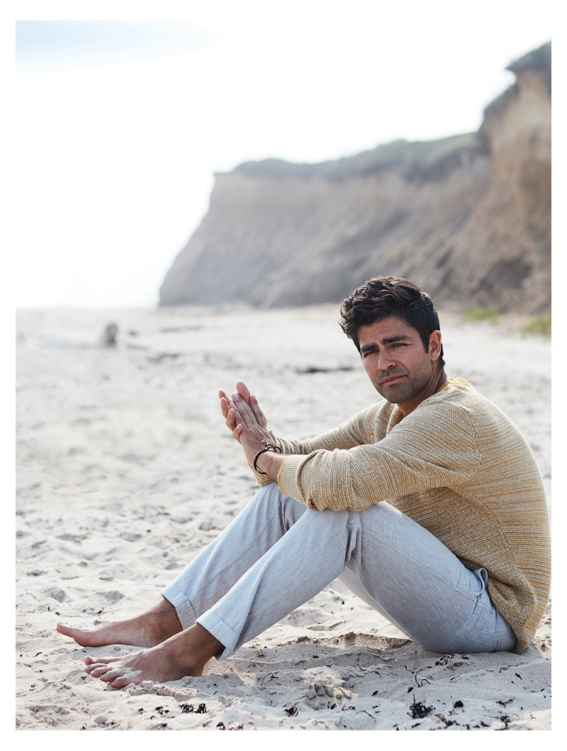 Taking to the beach, Adrian Grenier wears a Selected Homme sweater and life/after/denim trousers.