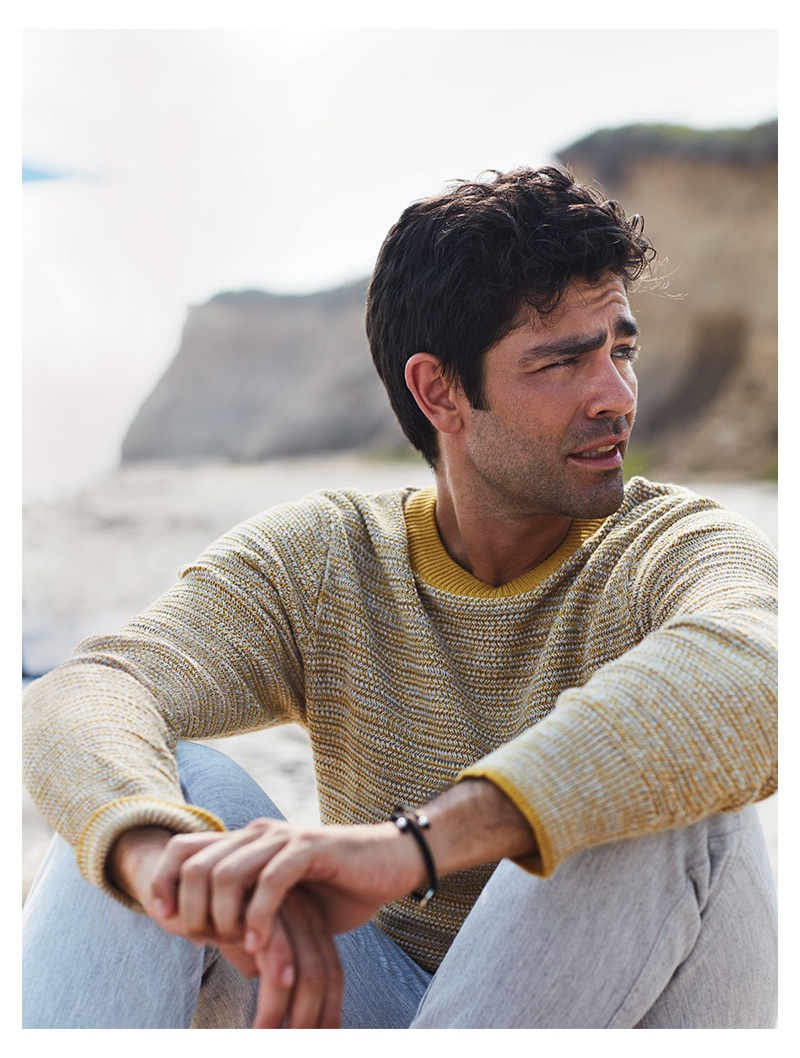 Starring in a new photo shoot, Adrian Grenier sports a Selected Homme sweater and life/after/denim trousers.