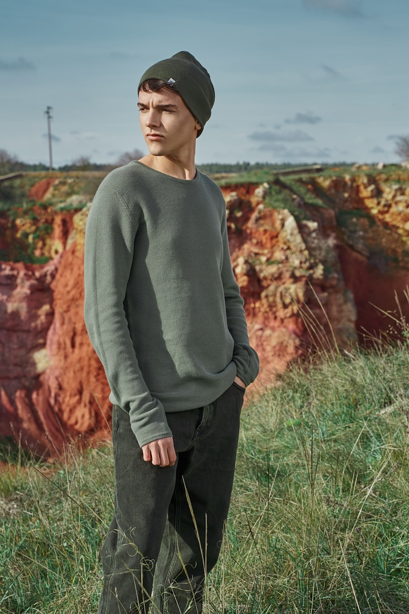 Alessandro wears knit beanie RVLT, sweater Minimum, and jeans Cheap Monday.