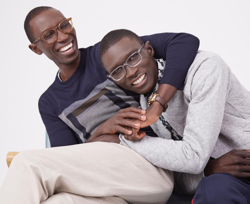 All smiles, models Armando and Fernando Cabral sport the latest styles from Warby Parker.
