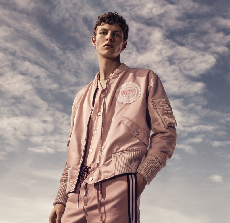 Donning a monochromatic number, Tim Schuhmacher appears in BOSS' spring-summer 2019 campaign.