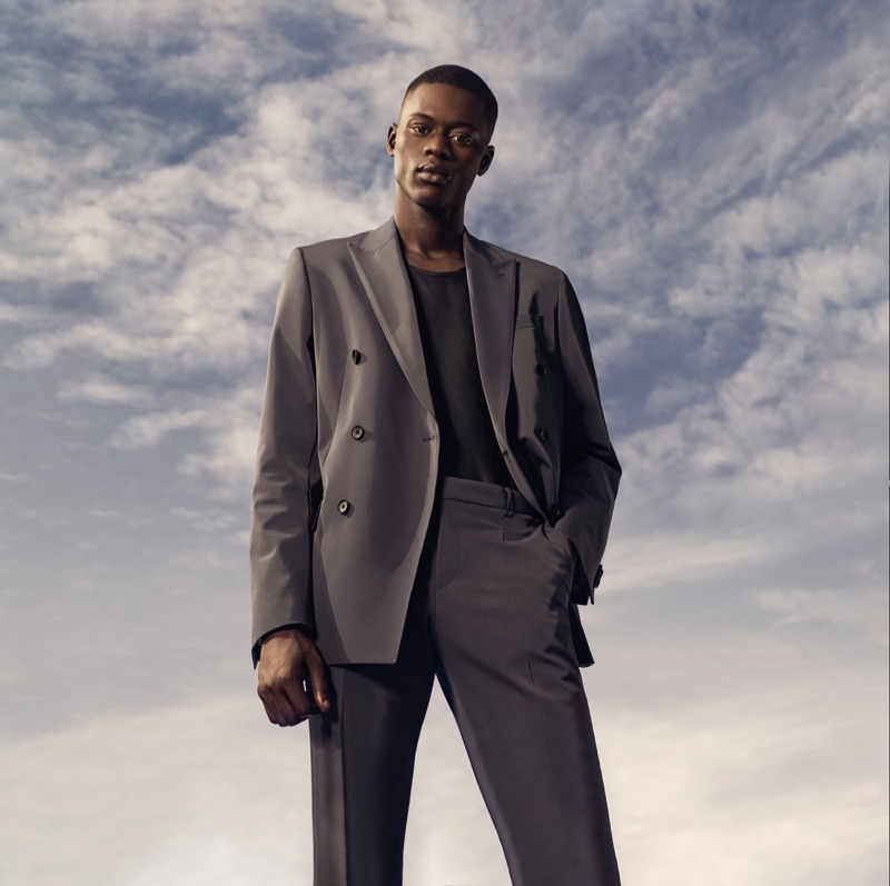 Model Alpha Dia sports a double-breasted suit for BOSS' spring-summer 2019 campaign.