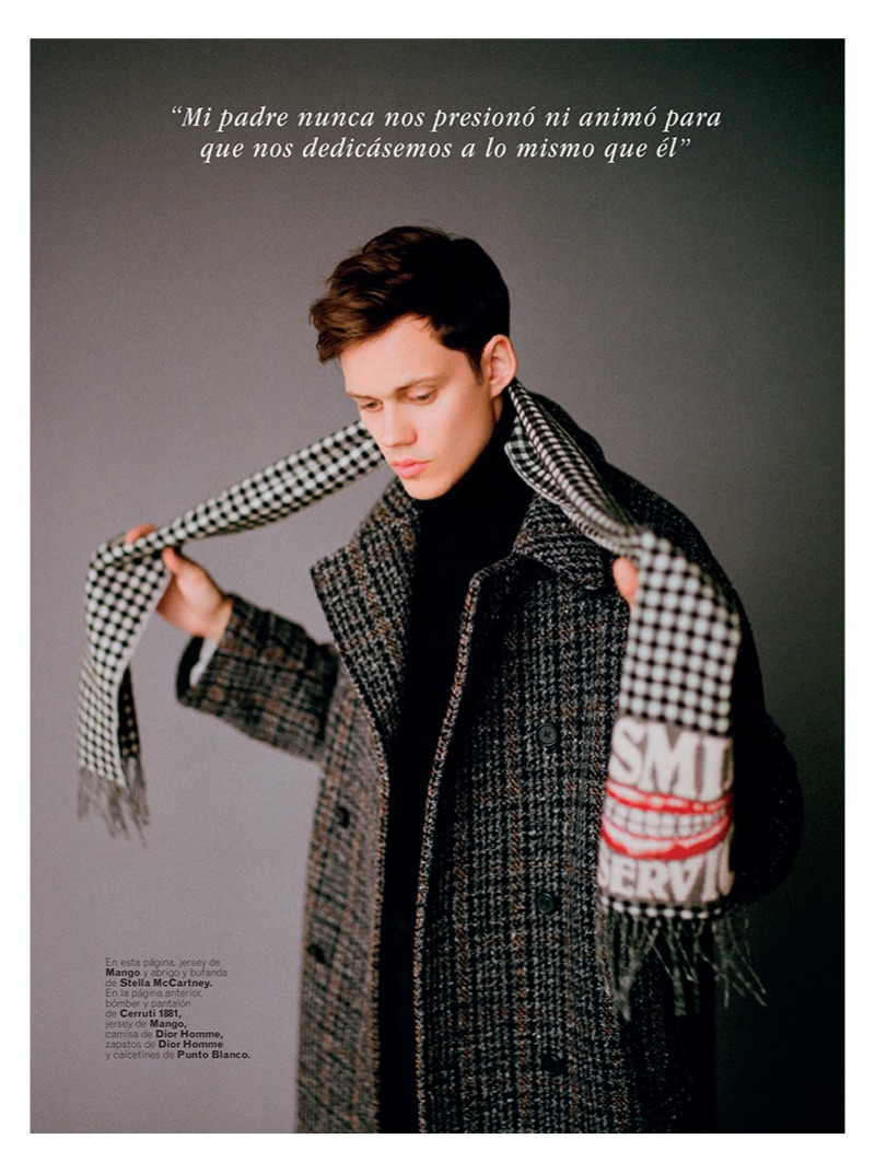 Sporting a Mango turtleneck sweater, Bill Skarsgård also wears a coat and scarf by Stella McCartney.