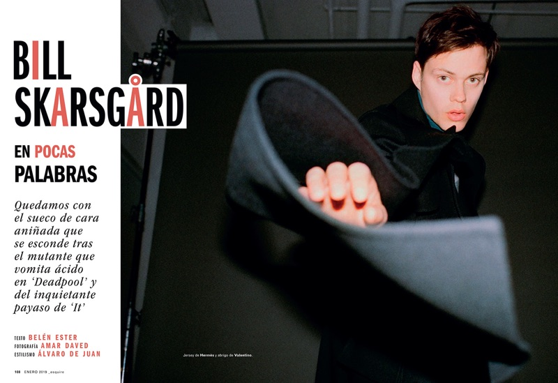 Starring in an Esquire España photo shoot, Bill Skarsgård dons a Hermès sweater with a Valentino coat.