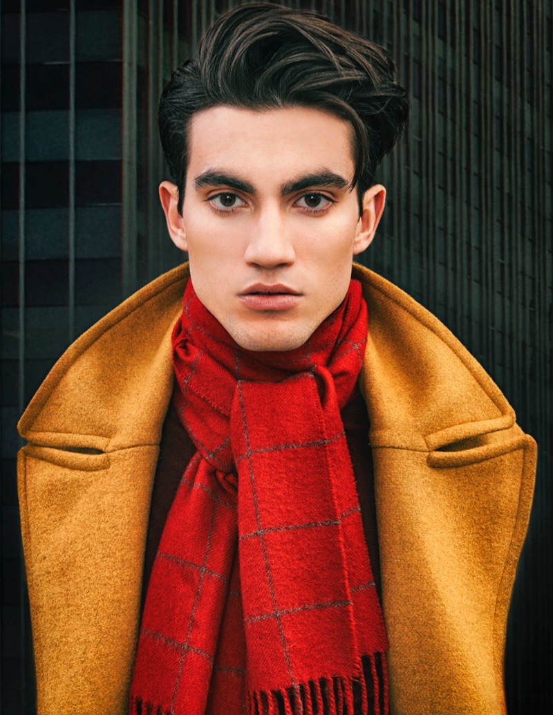 Brad wears scarf Calvin Klein, coat and sweater Mayer Man.