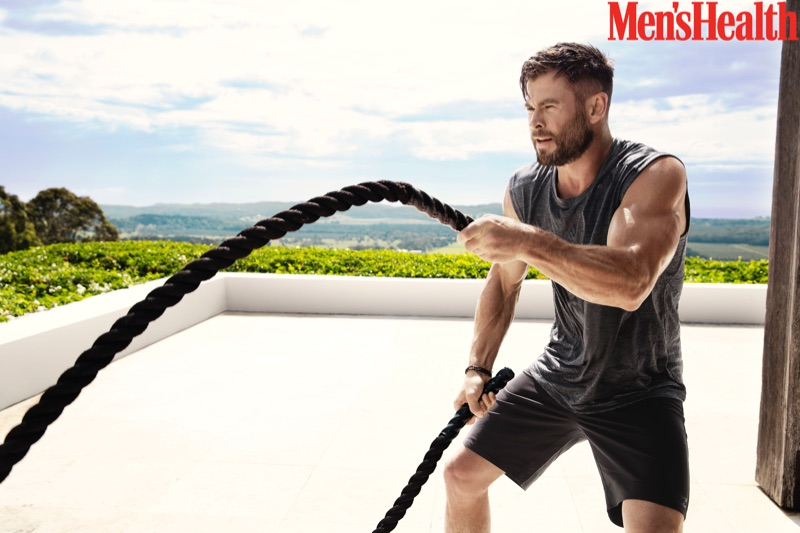 Working out, Chris Hemsworth appears in a new photo shoot for Men's Health.