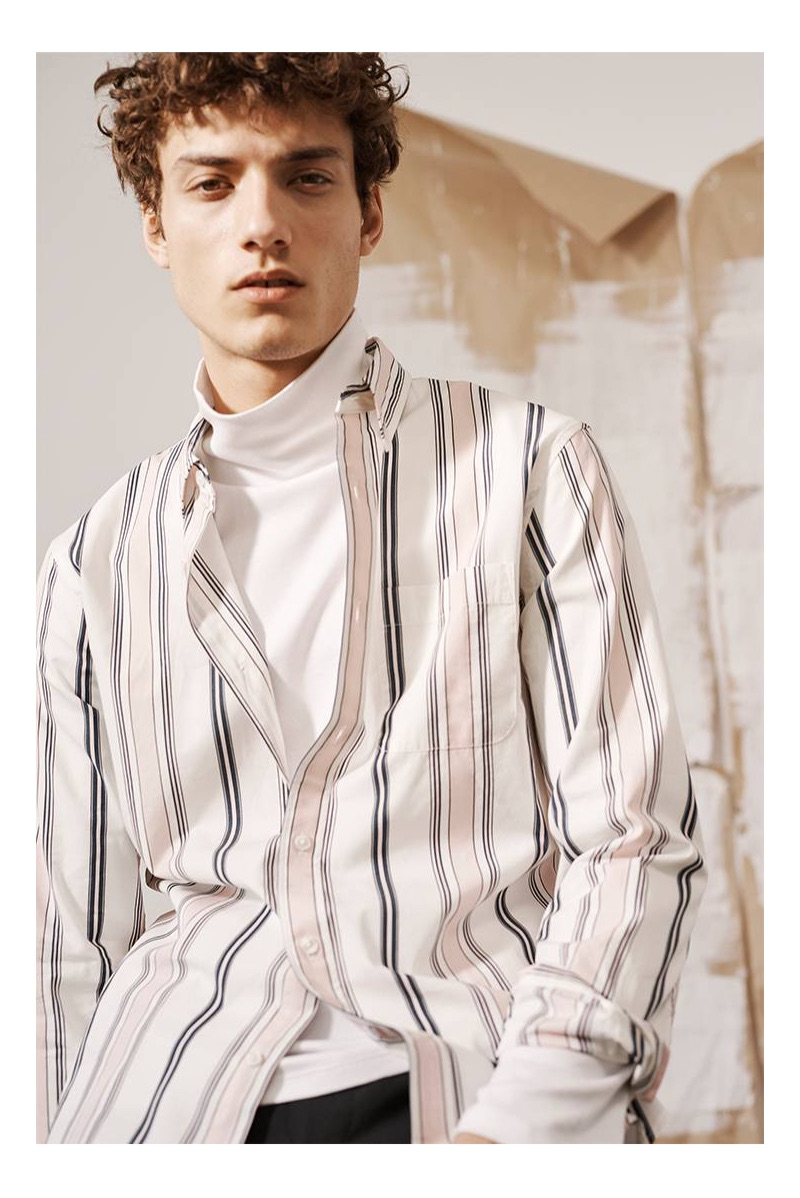 Layering, Serge Rigvava sports a Club Monaco striped shirt with a turtleneck.
