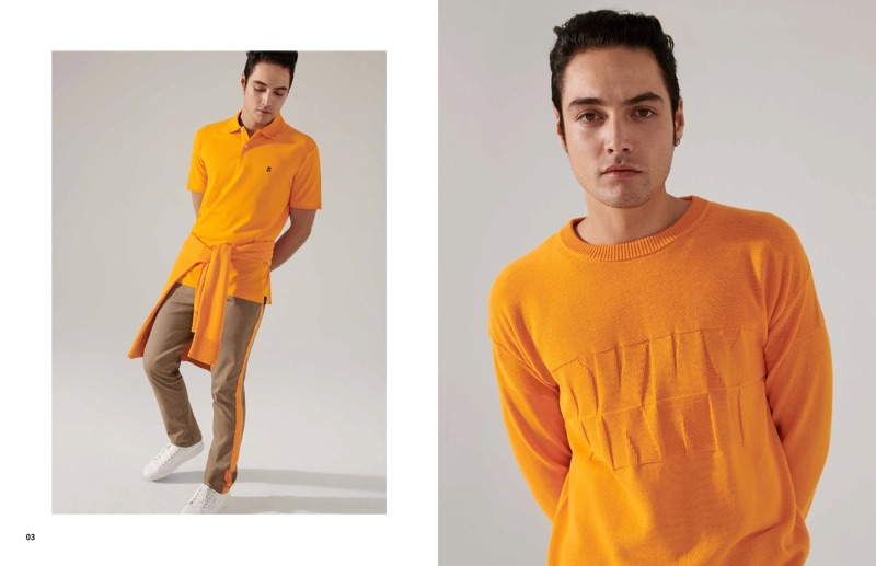 Standing out in orange, Levi Dylan wears DKNY.