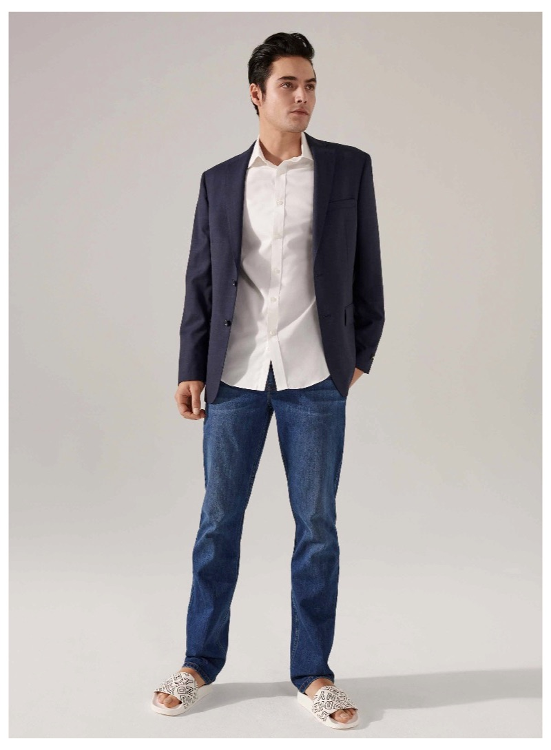 Embracing a smart casual look, Levi Dylan models DKNY.
