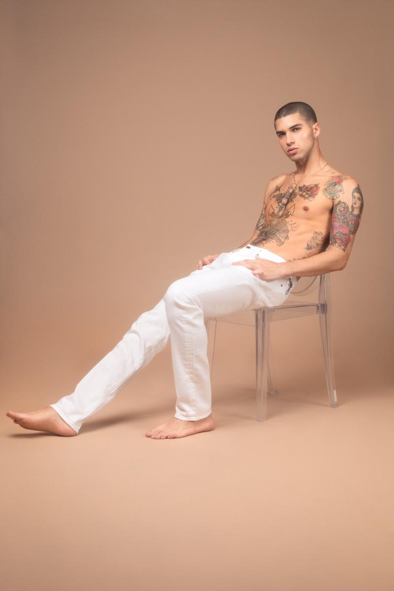 Daniel wears 7 For All Mankind jeans.