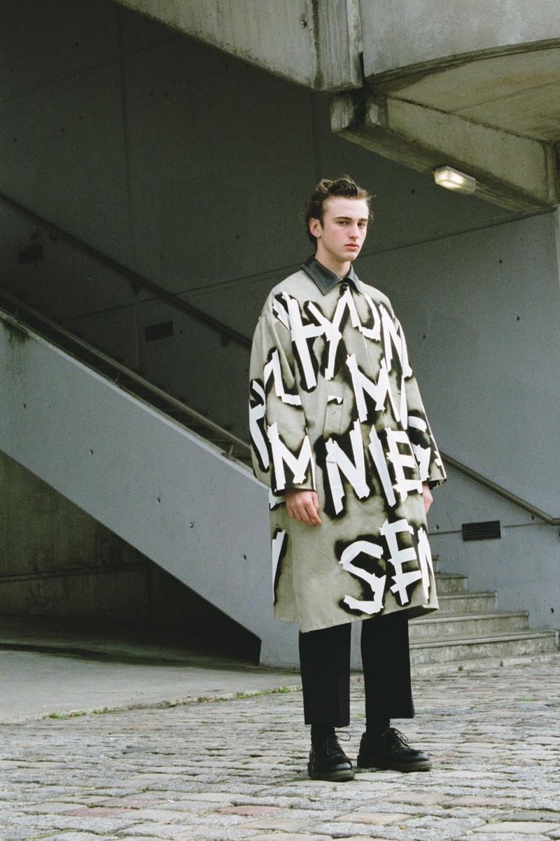 Thierry wears coat Hyun Mi Nielsen, pants COS, socks Falke, and shoes Comme des Garçons.