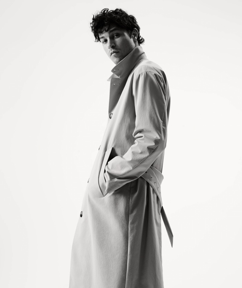 Wearing a timeless number, Miles McMillan dons a Giorgio Armani trench coat.