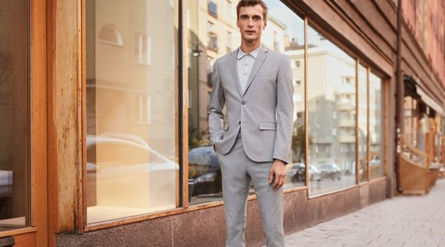 Clément Chabernaud sports a light grey skinny fit suit by H&M.