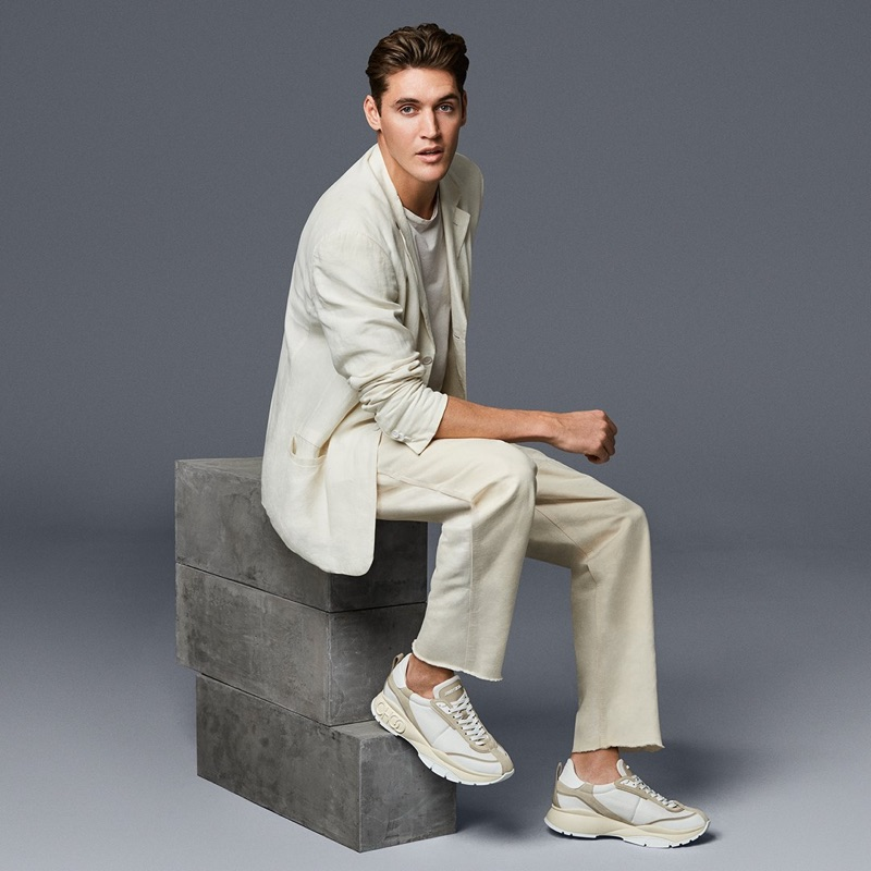 Sporting sneakers, Isaac Carew connects with Jimmy Choo for spring-summer 2019.