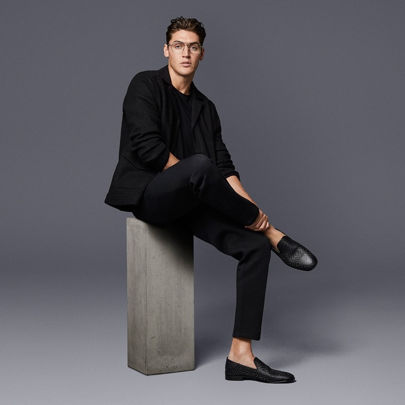 Making a refined statement, Isaac Carew wears Jimmy Choo's black embossed diamond weave leather fabric sneakers.
