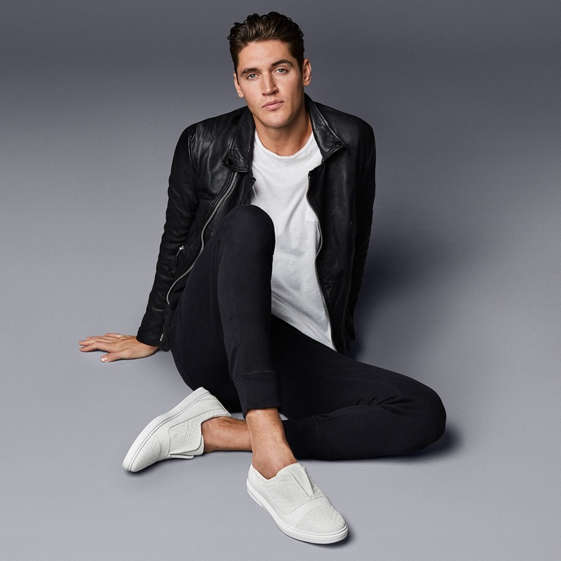 Front and center, Isaac Carew models Jimmy Choo's white embossed diamond weave leather and sport calf slip-on trainer.