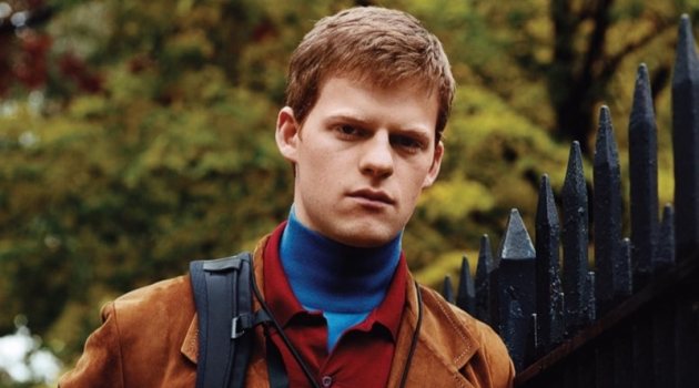 Actor Lucas Hedges dons a turtleneck, polo, and jacket by Prada.