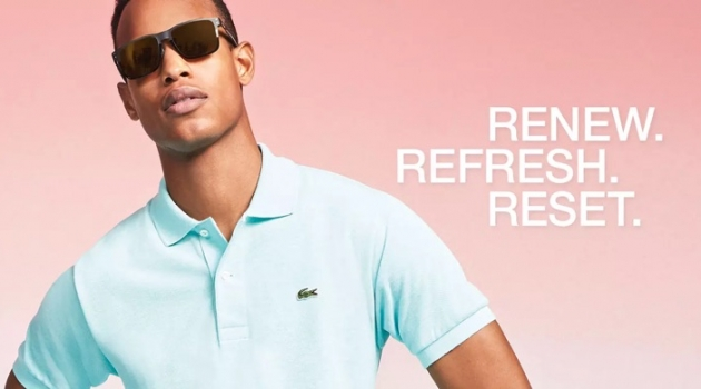 Conrad Bromfield embraces pastel spring style in a Lacoste polo shirt.