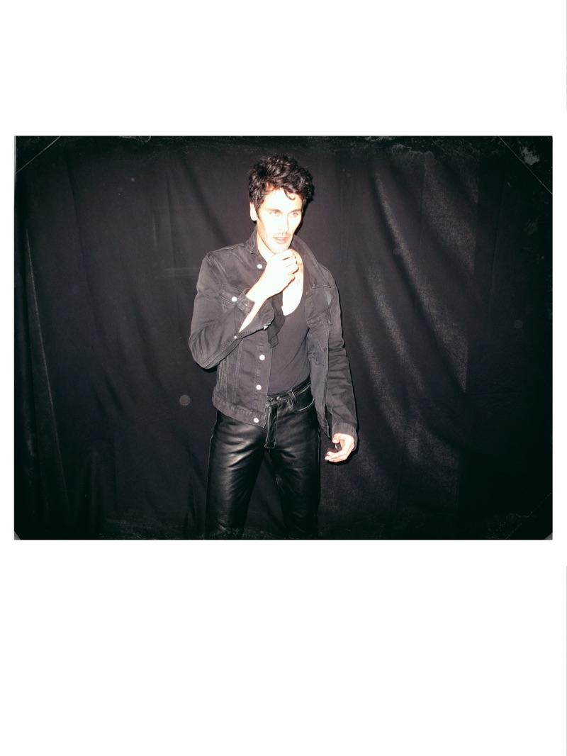 Pascal wears denim jacket Scotch & Soda, scarf stylist's own, tank American Vintage, and leather pants Saint Laurent.