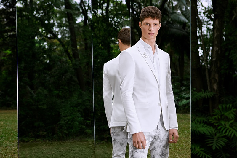 A vision in white, Douglas Lima fronts Ricardo Almeida's summer 2019 campaign.