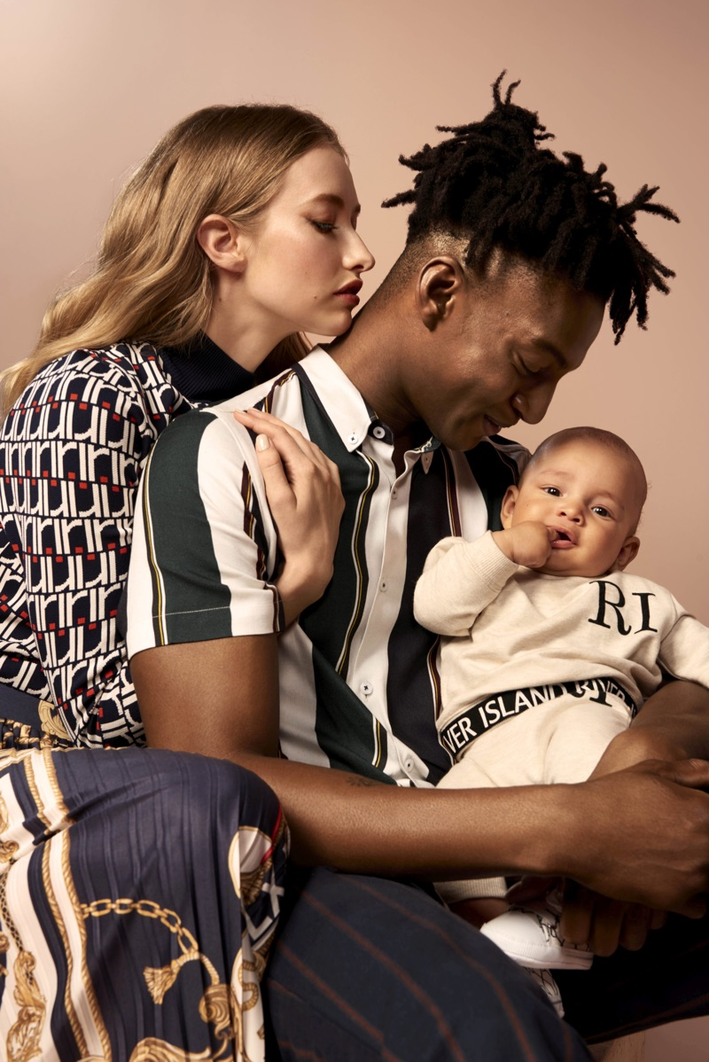Ty Ogunkoya poses with his family as part of River Island's spring 2019 campaign.
