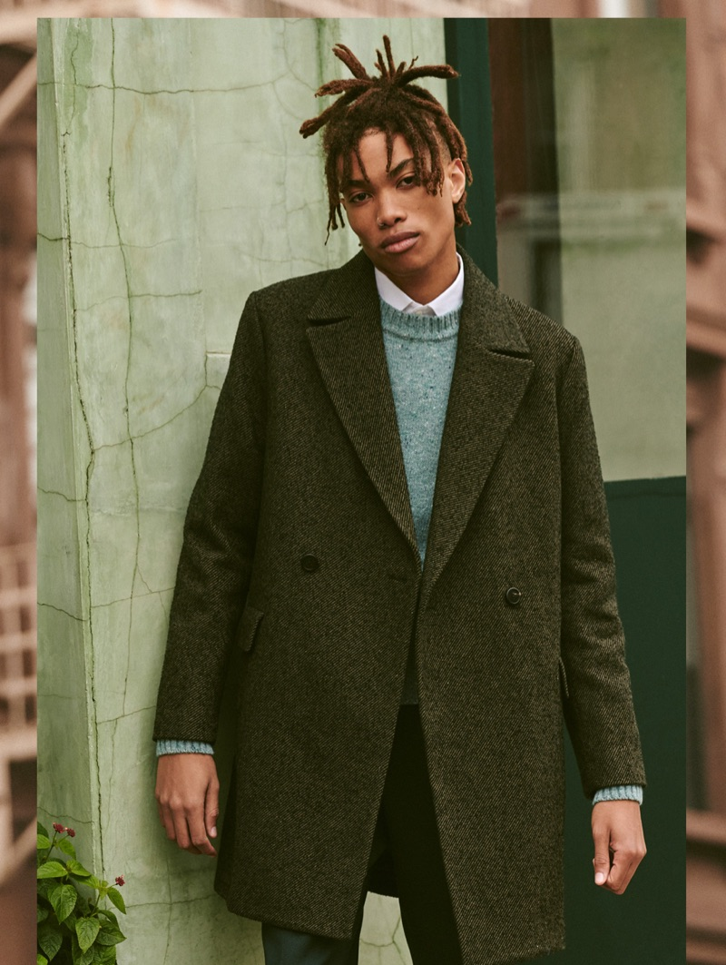 Model Seth Hill dons a Theory tuxedo shirt and coat with an AMI seater and trousers.