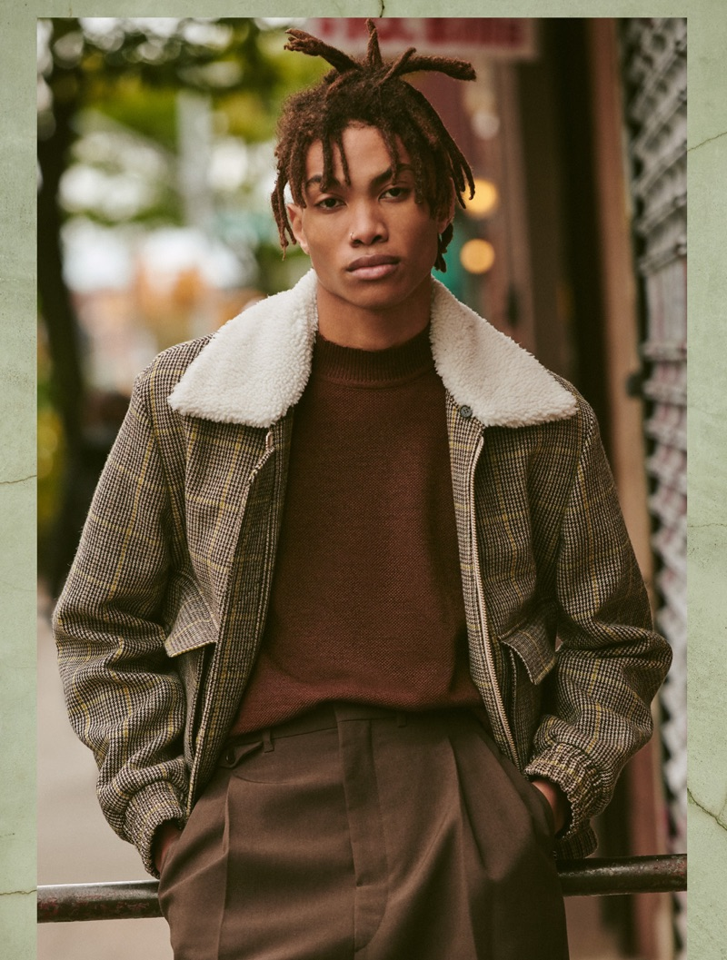 Reuniting with East Dane, Seth Hill sports a Kenzo jacket, De Bonne mock neck sweater, and Lemaire pleated trousers.
