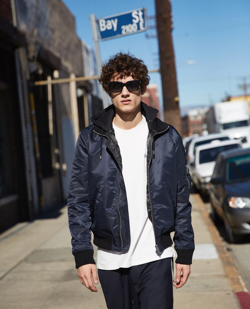 Going casual, Serge Rigvava wears a bomber jacket from The Kooples.