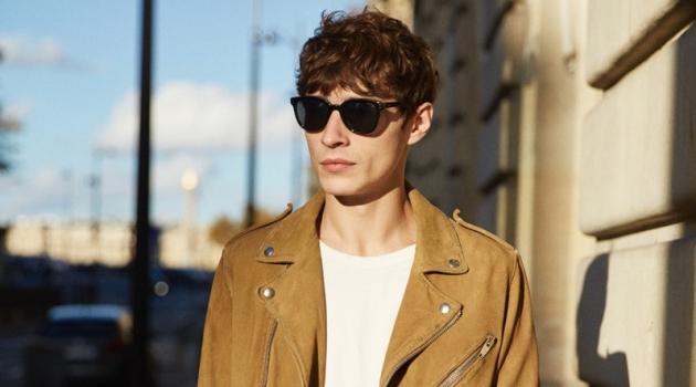 A cool vision, Adrien Sahores rocks a biker jacket by The Kooples.