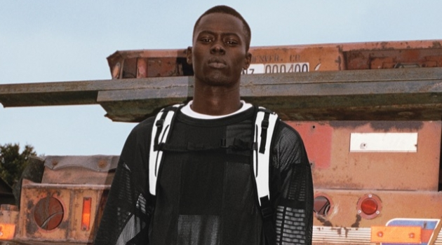 Alpha Dia models a black and white outfit for Y-3's spring-summer 2019 campaign.