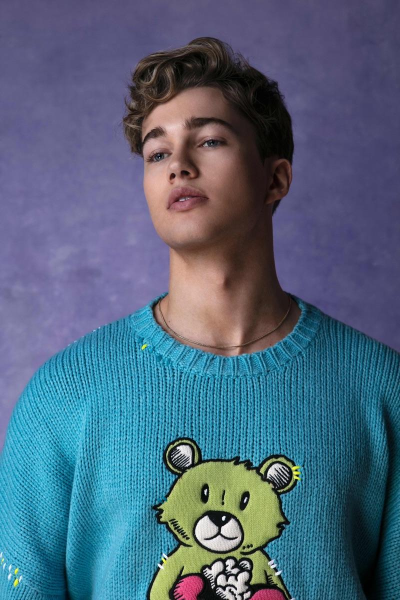 Dancer AJ Pritchard sports an AMIRI bear sweater.
