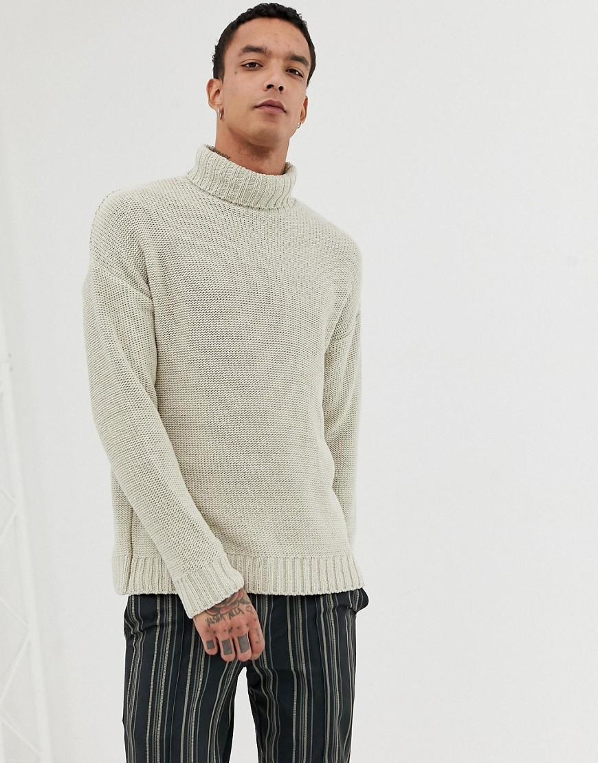 ad929234007 ASOS DESIGN knitted oversized roll neck sweater in beige - Beige