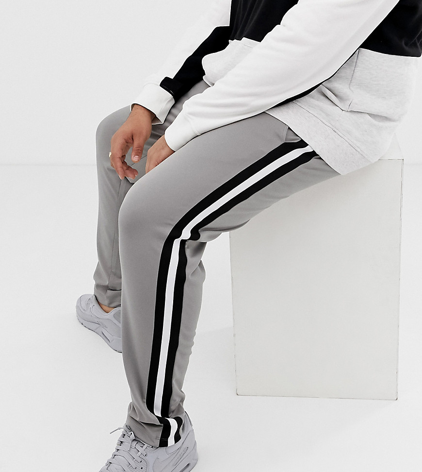 caee344f ASOS DESIGN Plus retro track skinny sweatpants with side stripe in gray -  Gray