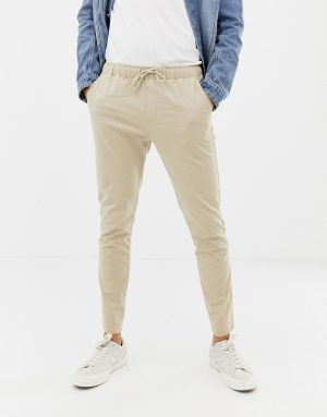 ASOS DESIGN skinny chinos in putty with elastic waist - Beige