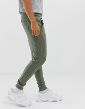 ASOS DESIGN skinny sweatpants with ribbed side stripe and acid wash - Green