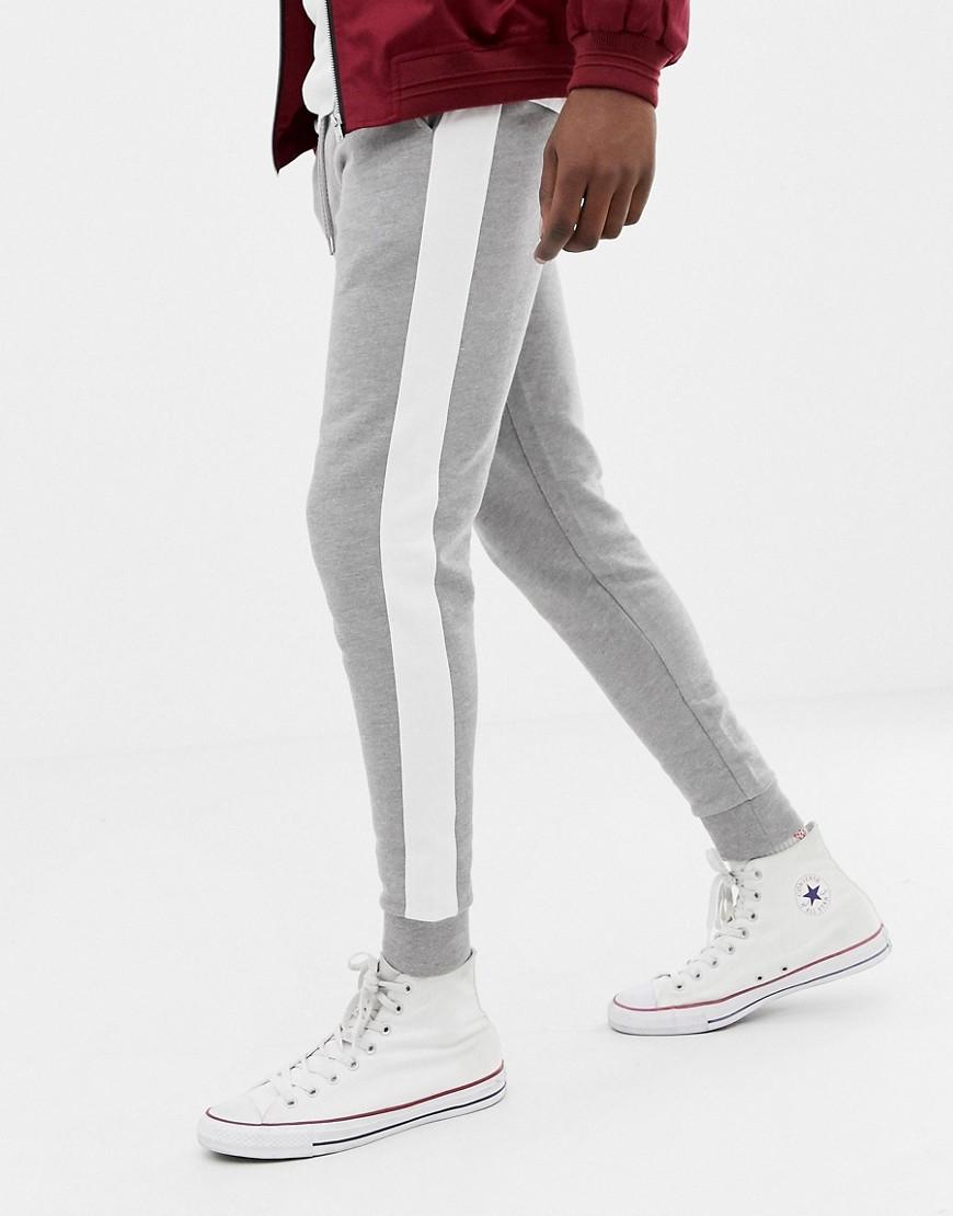 d3eeed95 ASOS DESIGN skinny sweatpants with side stripe in gray marl - Gray