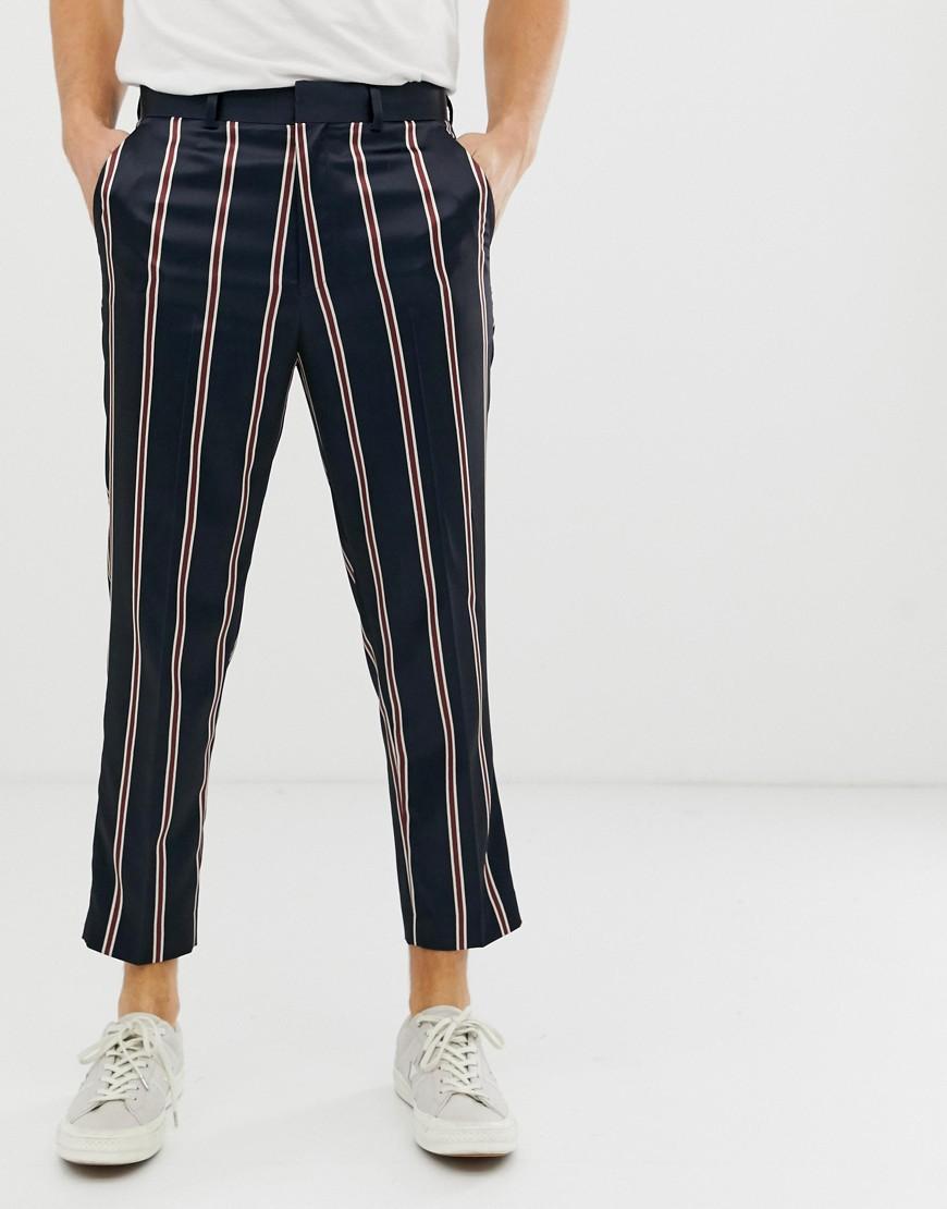 53a253cda8ad ASOS DESIGN tapered smart pants in navy satin stripe – Navy