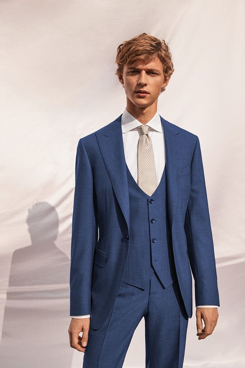 Max Barczak dons a blue three-piece suit from Canali's spring-summer 2019 wedding collection.